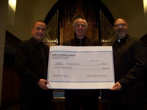 Pictured (LtoR): Music Director Omaldo Perez, Jeff Willbarger Executive Director of The Daughter's Project, Pastor Tim Philabaum
