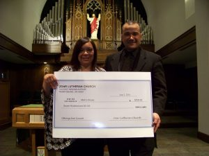 Pictured (LtoR): Christina Rodriguez Executive Director of Mom's House and Music Director Omaldo Perez
